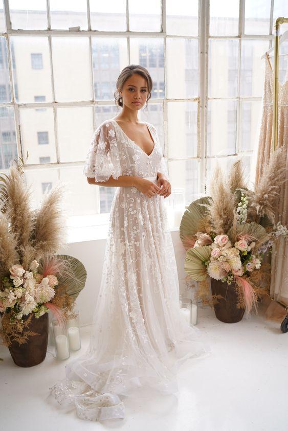 Svatební šaty s rukávy - Obrázek č. 23