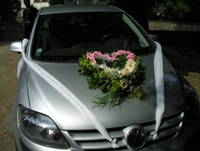 Flower heart on the bride's car