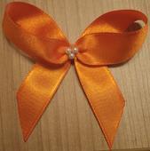 Sytě oranžové mašličky s perličkami - 16 ks,