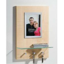 Koupený věšáček na klíče s rámečkem na naší fotku. (Kika)