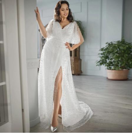 Luxusné svadobné šaty do veľ. 56 - Obrázok č. 1
