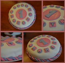 dortík na objednávku k 1. narozeninám, piškot, šlehačka s malinami a čokokrém