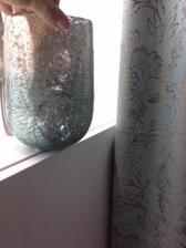vaza ci co to je doladena k zavesu ,muz to nazval konzerva obyta :)