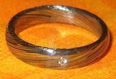 Prsten se zirkonem - damascénská ocel (vel. 54),