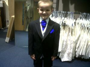 my oldest in his suit, lookin all proud