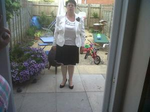 mother of the bride outfit. she could of smiled lol