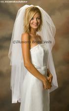 závoj jsem nechtěla, ale paní v salonu řekla bez závoje nejste pořádná nevěsta:), tak mám tento