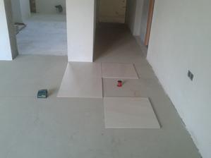 Prízemie - Obývačka Jul_16_2013 - príprava na ukladanie dlažby - rozmeranie dlažby