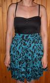 Černomodré šaty, L