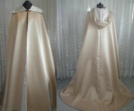 něco podobneho v bile a s rukavem šije maminka aby ženich neviděl šaty do obřadu :-)   (to ale neni z moji hlavy..)