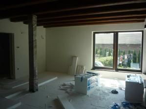 Zateplovanie podlahy pred realizáciou podlahového vykurovania. Zaujímavá práca i keď po nej ostáva poriadny bordel.