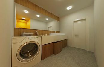 spodná kúpelňa s práčkou a sprchovým kútom