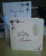 Partly finished wedding invites and order of service booklet