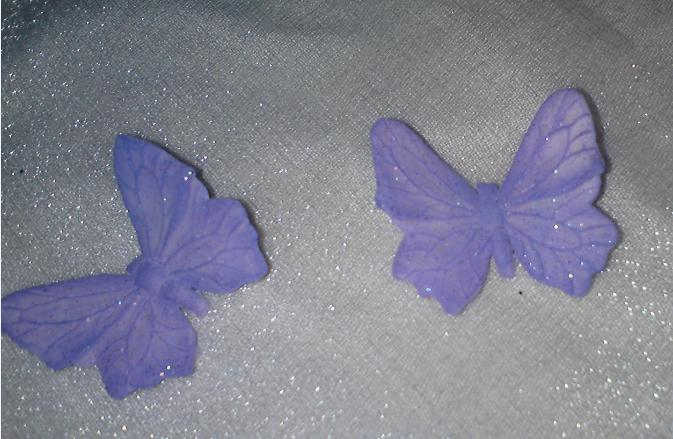 Wedding stuff - icing butterflies for cake (Need to be light blue instead of purple), they are more glittery but doesn't show up on the photos