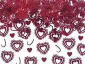 Konfety červené vyrezávané srdiečka,