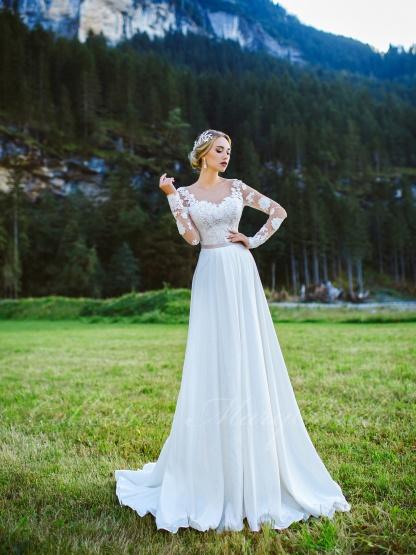 Sníte o lehkých elegantních šatech s dlouhým rukávem? Pak Vás jistě osloví tento velmi oblíbený a žádaný model. Těšíme se na Vaši návštěvu. - Obrázek č. 1