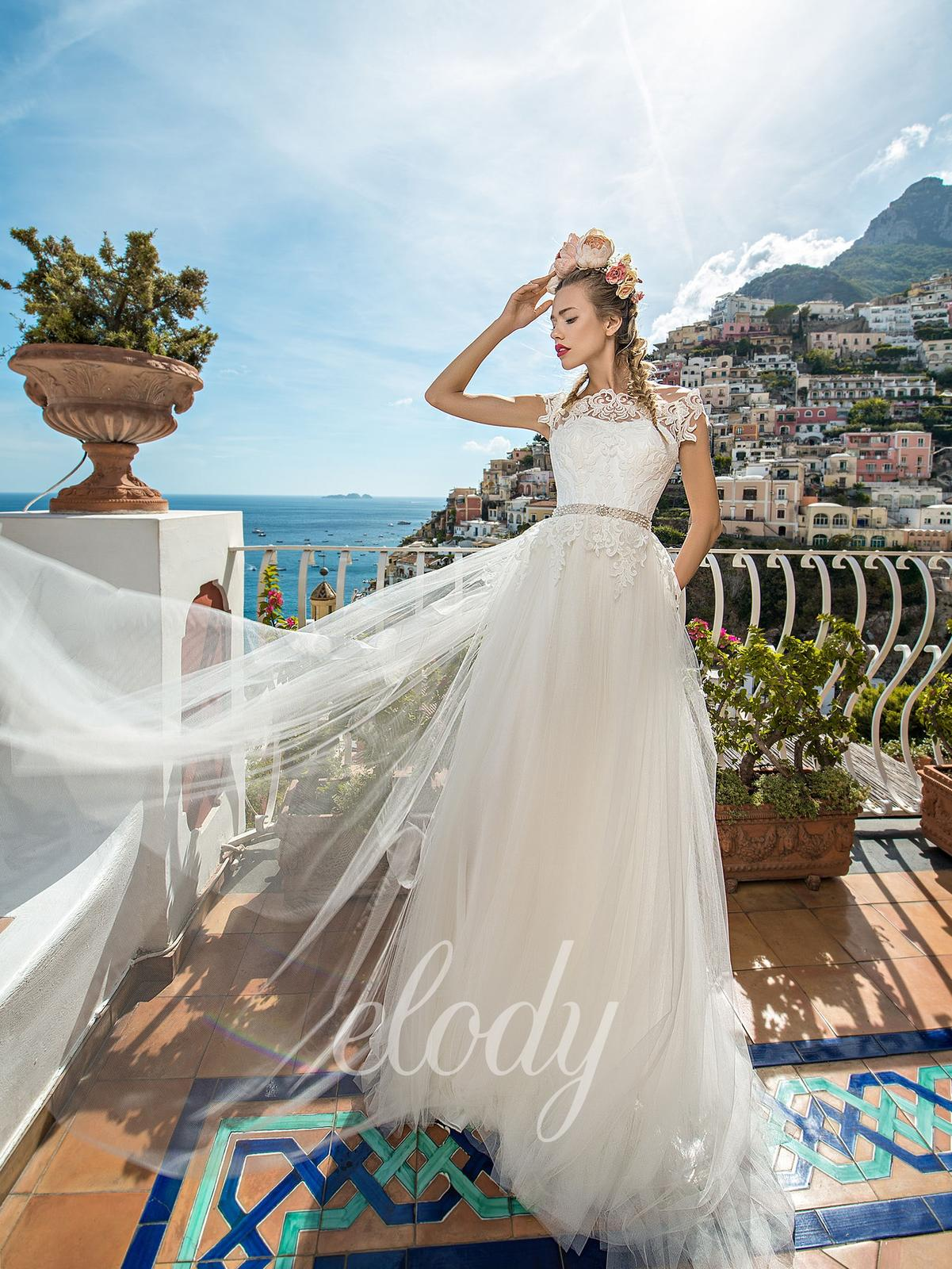 Na prodej krásné, jednou použité svatební šaty zn.ELODY ve vel. 40. Prodejní cena 8400 Kč. Budete-li mít o tyto šaty zájem, zavolejte a domluvíme se na termínu - Obrázek č. 1