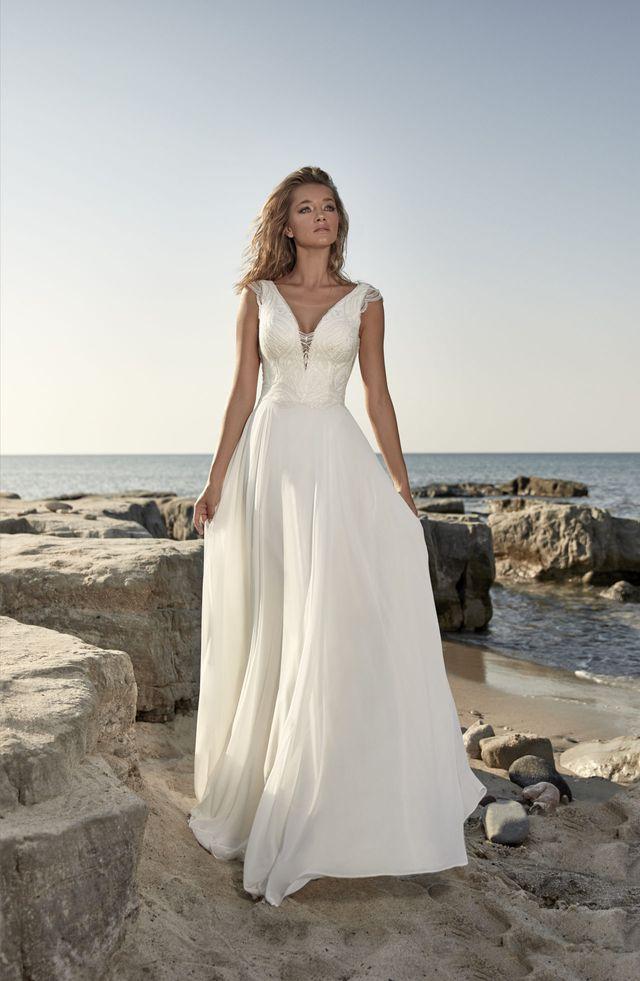 Na prodej nádherné lehké svatební šaty s živůtkem pokrytým francouzskou krajkou z kolekce  světoznámé značky HERVÉ PARIS model Targon v barvě Ivory a ve vel.40. - Obrázek č. 1
