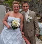 Svadobné šaty s vlečkou a bolerkom, 38