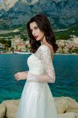 Elegantné svadobné šaty zdobené korálkami, 50