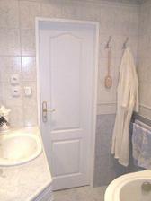 Šílené umakartové jádro jsme nahradili zděnou koupelnou.