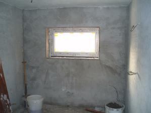 25.4.2010 Už máme okno i v koupelně, zatím s provizorním sklem, ale jsem ráda, že už dovezli aspoň pár oken a může se začít obkládat.