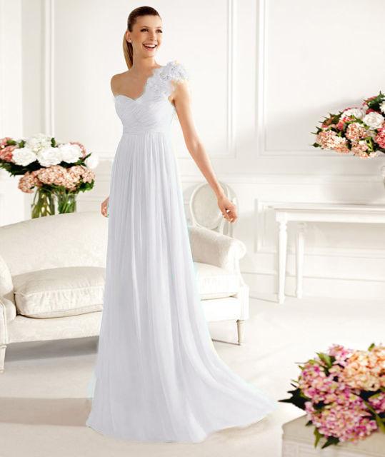 Letní výprodej svatebních šatů - velikost 38-cena 2300kč
