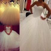 nepoužíté svatební šaty , 36