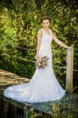 Krajkové svatební šaty s vlečkou, 34