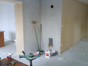 prechod do kuchyne v rohu budu krbové kachle a stena bude obložena s kamenom.