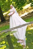 Svadobné šaty jemnej smotanovej farby, 44