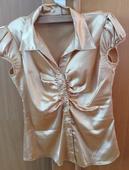 Zlatá saténová košile, 38