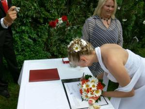 ona podepsala...