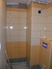 27/02/08...obklady v pulce wc jsou hotovy, chybi jen posledni hnedy pruh a podlaha