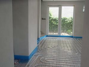 Položené podlahové kúrenie v celom dome.