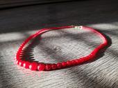 Červený náhrdelník,