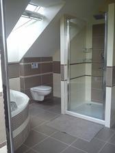 Sprchové dveře namontovány...